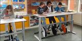 Deskbike im Klassenraum | gesund und ergonomisch arbeiten | Deskbike | Worktrainer.de | Schreibtischfahrrad |  Sattelstange